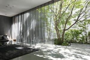 الواجهات الديناميكية بيت الزجاج البصري Glass Optical House